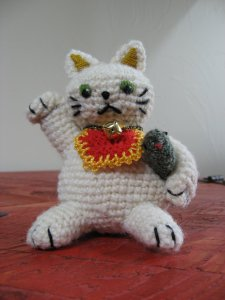 A knitted cat like the one that waves in Japanese restaurants