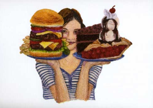 burger and cake in hand of girl